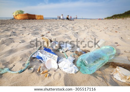 Garbage on a beach left by tourist, environmental pollution concept picture, Baltic Sea coast, Poland. - stock photo