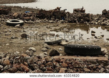 garbage on coast - stock photo