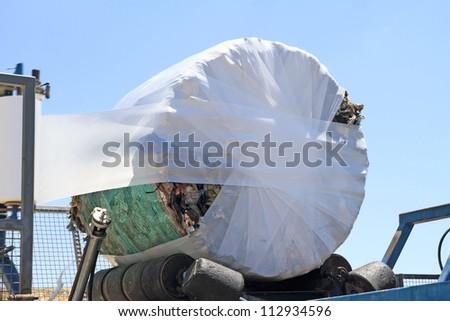 Garbage packing machine in landfill - stock photo