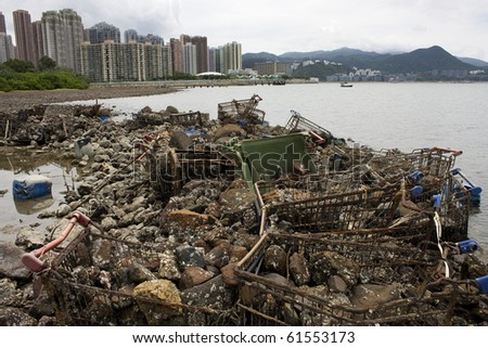Garbage piled up on the coast of the ocean - stock photo