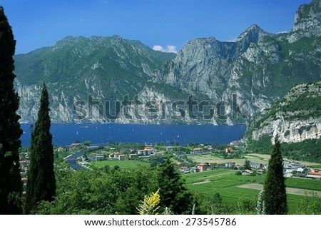 Garda Lake with Alps and vilage Linfano  in a Sunny Day, Malcesine Province, Italy