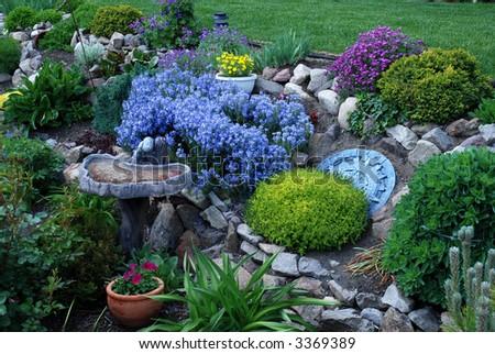Garden Bird Bath and Plaque - stock photo