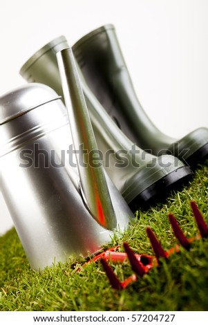 Garden boots with tool - stock photo