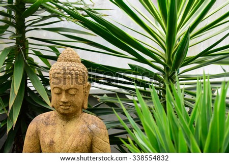 Garden Buddha - stock photo