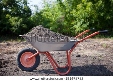 garden cart with ground on background of trees and soil