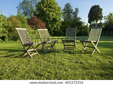 Garden Furniture On Grass garden chair stock images, royalty-free images & vectors