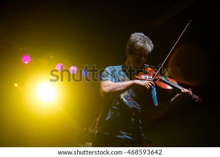 GARDEN CITY, IDAHO - JULY 26, 2016: David Ragsdale from Kansas using his violin on stage at the Revolution Concert House