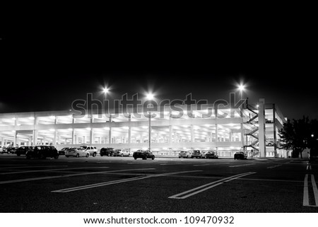 GARDEN CITY, NY - JULY 18: Parking garage at night at historical Roosevelt Field Mall, Garden City, NY on July 18, 2011.  Charles Lindbergh made his historic transatlantic solo flight from this site. - stock photo