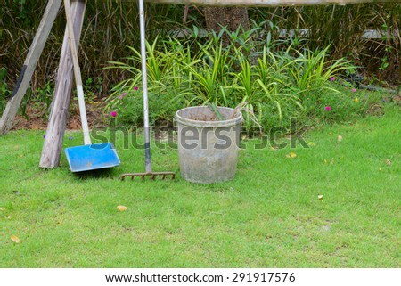 garden cleaning tool put on grass in garden after use already