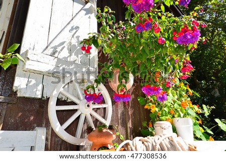 Garden Cottage in the summer with many flowers