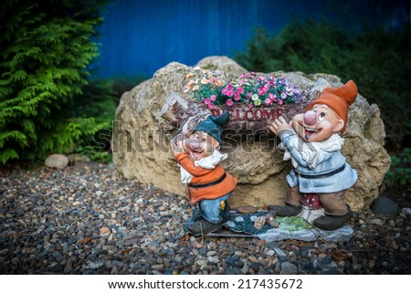 Garden decoration statue, small ceramic figure - stock photo