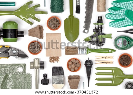 garden equipment and other essentials on white background. gardening flat lay concept - stock photo