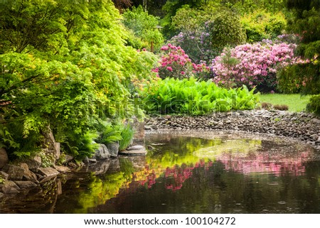 Garden full of flowers - stock photo