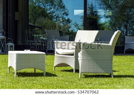garden furniture in the home garden two chairs and one table