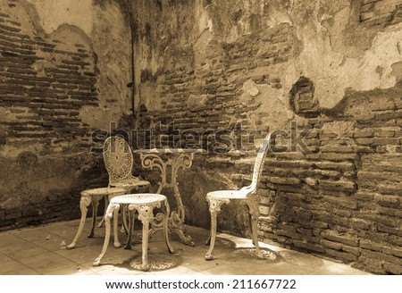 Garden furniture set with old brick wall black and white version