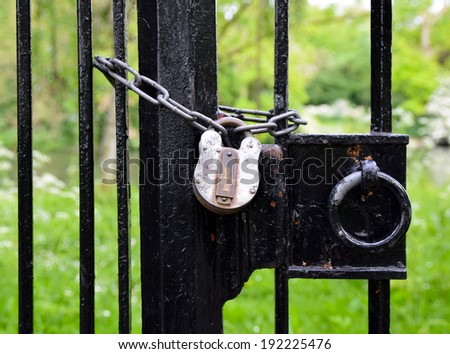garden gate locked with chain and padlock