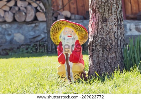 Garden gnome in an autumn garden in the grass - stock photo