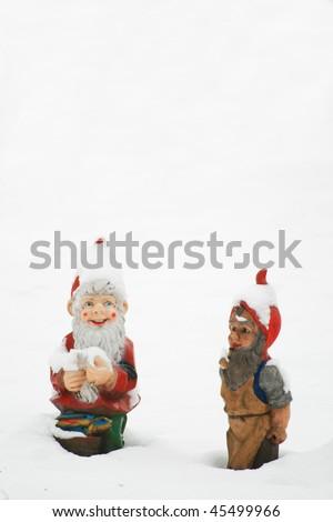 garden gnome in winter - stock photo