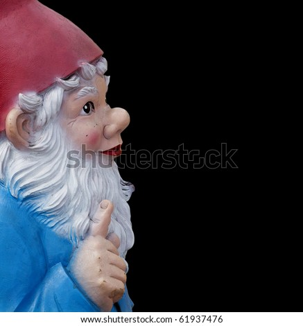garden gnome with a wagging finger isolated on black - stock photo