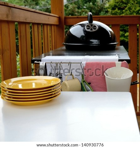 garden grill with plate and table - stock photo