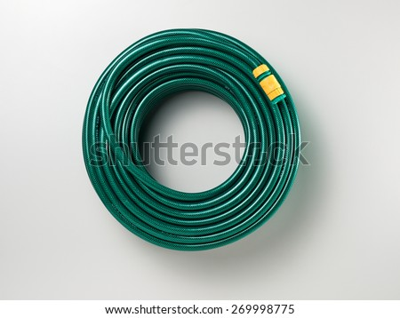 Garden Hose Isolated On A White Background With Soft Shadow. Top View Of A  Classic