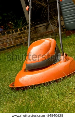 Garden hover lawn mower on grass - stock photo