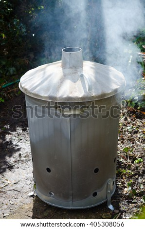 Garden incinerator bin burning waste from the garden.