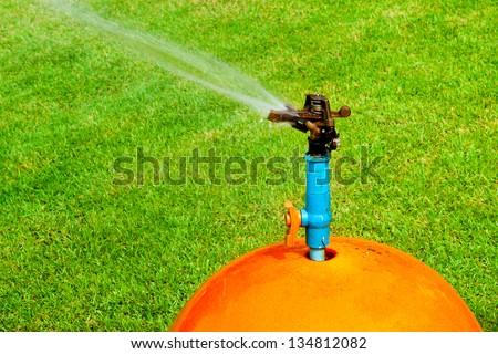 Garden lawn water sprinkler. - stock photo