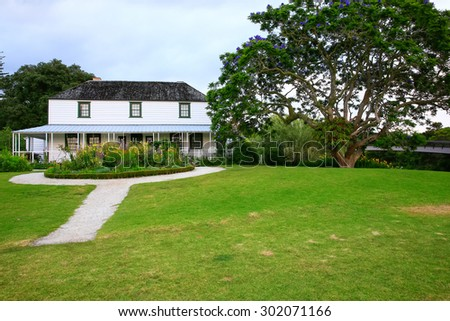 Garden near museum Kemp House is New Zealand. It is oldest wooden building. White old house. January, 2015