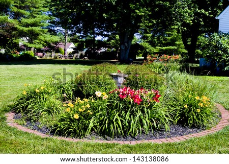 Garden of day lilies in yard - stock photo