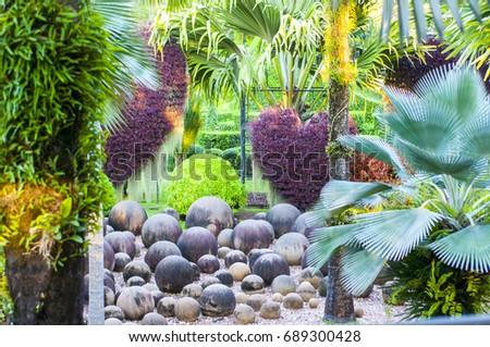 Garden stone balls beautiful landscape design stock photo 689300428 garden of stone balls beautiful landscape design in tropics workwithnaturefo