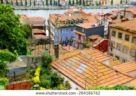 Garden on the rooftop and red tiled roofs houses of old city. Porto, Portugal. - stock photo