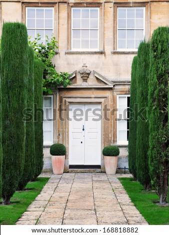 Garden Path Leading to a Georgian Era English Mansion - stock photo