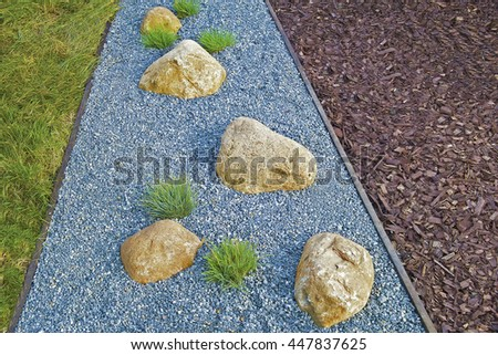 Garden Path Of Blue Pebbles With Stones With Gravel And Grass. Mulching.  Landscaping Concept