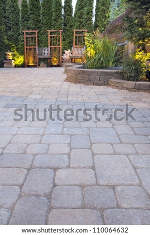 Garden Paver Patio with Trellis Japanese Stone Lantern Pagoda Waterfall Pond and Landscaping Lights - stock photo