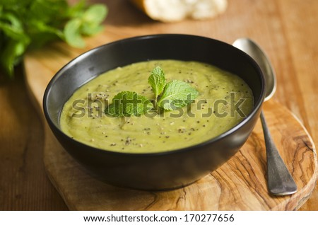Garden pea and shredded ham soup - stock photo