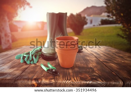 garden pots and garden shoes and wooden old table place  - stock photo