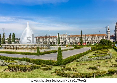 Garden Praca do Imperio and Jeronimos Monastery in Lisbon, Portugal, Belem District. - stock photo