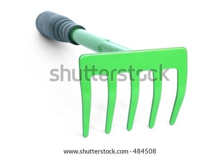 Garden rake on white background - stock photo