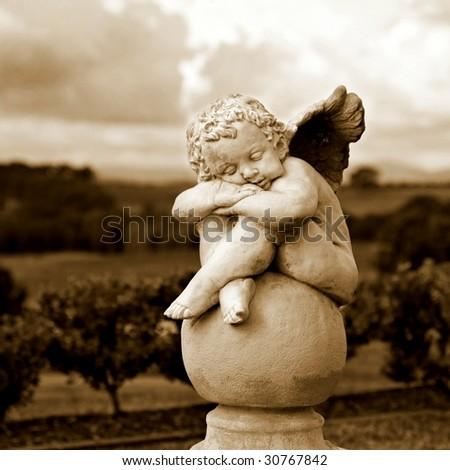 Garden Sculpture in Sepia - stock photo
