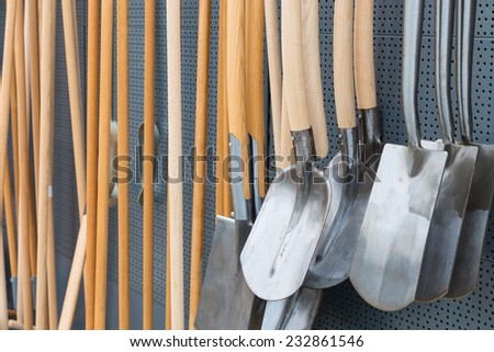 Garden shop with wooden spades for sale - stock photo