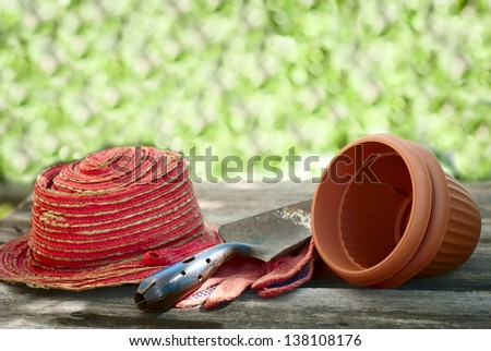 garden shovel, gloves, hat and clay pots