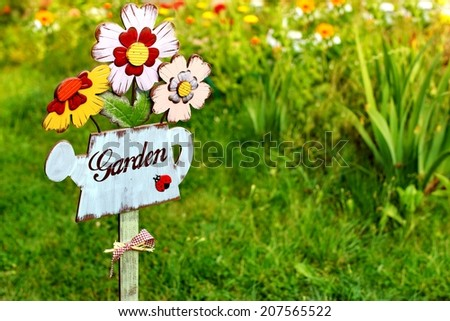 Garden sign, message on a wooden watering can. Background with space for text or image. - stock photo