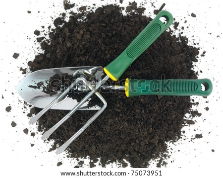 Garden soil and implements isolated against a white background - stock photo