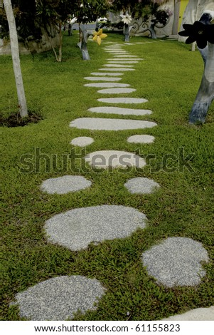 garden stone path with grass. thailand - stock photo