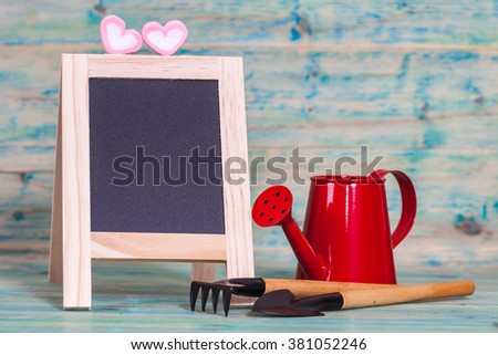 garden tool and red watering can. - stock photo