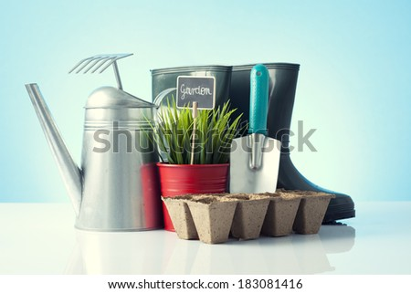 garden tools on blue background - stock photo