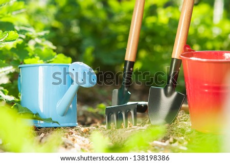 Garden tools on green background - stock photo