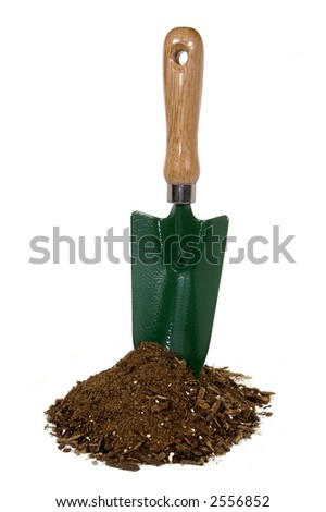 garden trowel upright in mound of soil on white background - stock photo