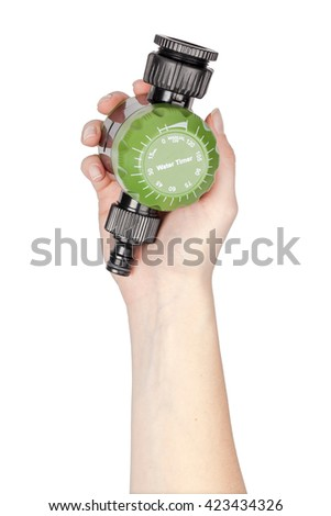 garden water timer in a hand isolated on white background. gardening tools - stock photo